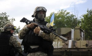 Ukrainian servicemen stand at the military camp near the town of Svyatogorsk