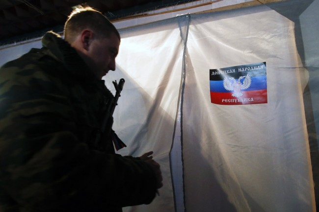 A pro-Russian separatist enters a voting booth during the self-proclaimed Donetsk People's Republic leadership and local parliamentary elections at a polling station in the southern coastal town of Novoazovsk November 2, 2014. Pro-Russian separatists will vote to set up a breakaway regional leadership in eastern Ukraine on Sunday aiming to take their war-torn region closer to Russia and defying Kiev and the West as the big guns still boom across the territory. REUTERS/Maxim Zmeyev (UKRAINE  - Tags: ELECTIONS POLITICS CIVIL UNREST)