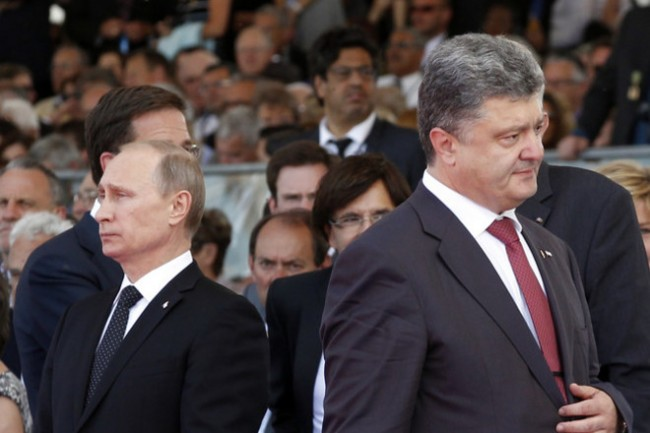 epa04242873 Ukraine's President-elect Petro Poroshenko (R), walks past Russian President Vladimir Putin during the commemoration of the 70th anniversary of the D-Day in Ouistreham, France, 06 June 2014. More than 75,000 British Canadian and other Commonwealth Troops Landed on the beaches of Normandy on 06 June 1944 alongside the United States and the Free French, in an Allied invasion of more than 130,000. Another 7,900 British troops were landed by Air.The invasion established a crucial second front in the Liberation of Europe from Nazi occupation, ultimately leading to victory for Allied Forces in 1945. EPA/CHRISTOPHE ENA / POOL MAXPPP OUT