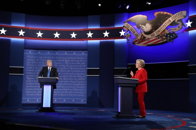 epa05557673 Republican Donald Trump (L) and Democrat Hillary Clinton (R) debate during the first Presidential Debate at Hofstra University in Hempstead, New York, USA, 26 September 2016. The only Vice Presidential debate will be held on 04 October in Virginia, and the second and third Presidential Debates will be held on 09 October in Missouri and 19 October in Nevada.  EPA/ANDREW GOMBERT