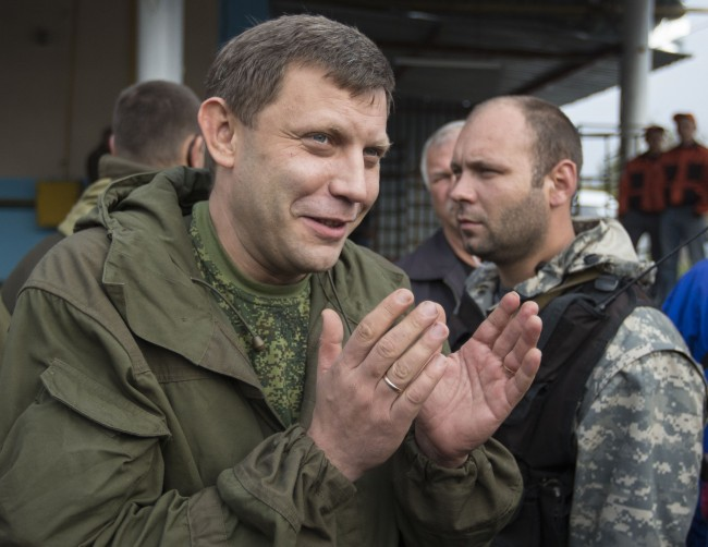 Prime Minister of the self-proclaimed Donetsk People's Republic Alexander Zakharchenko (L) gestures during his election campaign tour to the southern coastal town of Novoazovsk, October 18, 2014. REUTERS/Shamil Zhumatov (UKRAINE - Tags: POLITICS CIVIL UNREST CONFLICT)