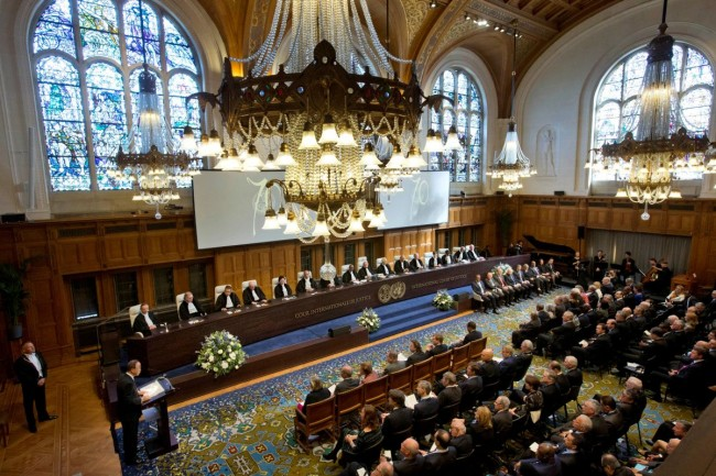 FILE PHOTO: United Nations Secretary-General Ban Ki-moon, down left corner behind lectern, speeches during a ceremony marking the 70th anniversary of the International Court of Justice in The Hague, Netherlands, Wednesday, April 20, 2016. REUTERS/Peter Dejong/Pool/File Photo