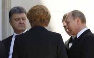 Putin, Poroshenko and Merkel talk in Benouville