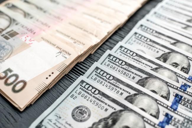 Pile of Ukrainian and American money banknots