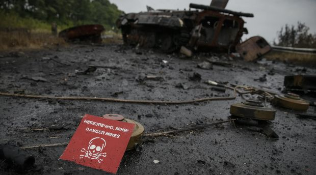 Ammunition and landmines lie near a destroyed military vehicle of pro-Russian separatists just outside the eastern Ukrainian town of Slaviansk