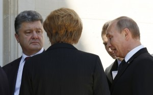 Putin, Poroshenko and Merkel talk in Benouville