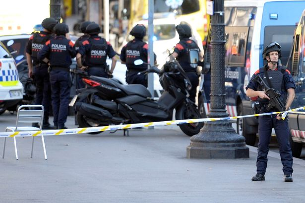 Armed-policecen-stand-in-a-cordoned-off